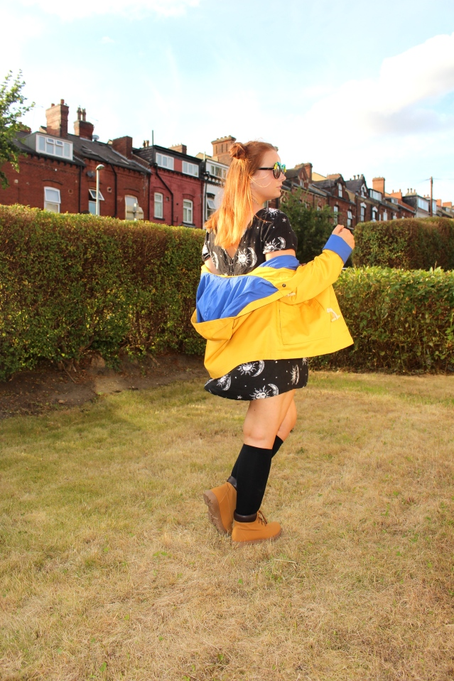 Festival fashion inspo yellow fisherman raincoat motel dress and cat boots-006